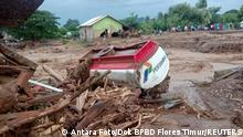 A damaged truck is seen at an area affected by flash floods after heavy rains in East Flores, East Nusa Tenggara province, Indonesia April 4, 2021, in this photo distributed by Antara Foto. Picture taken April 4, 2021. Antara Foto/Handout/Dok BPBD Flores Timur/ via REUTERS ATTENTION EDITORS - THIS IMAGE WAS PROVIDED BY THIRD PARTY. MANDATORY CREDIT. INDONESIA OUT.