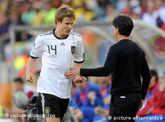 Holger Badstuber (l) of Germany shakes hands with head coach Joachim Loew