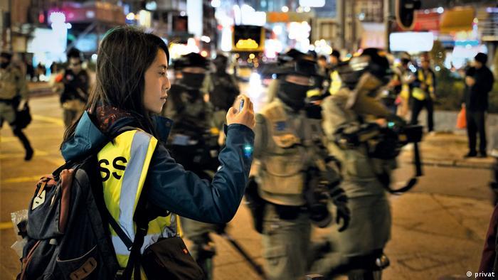Phoebe Kong at an evening demonstration in Hong Kong