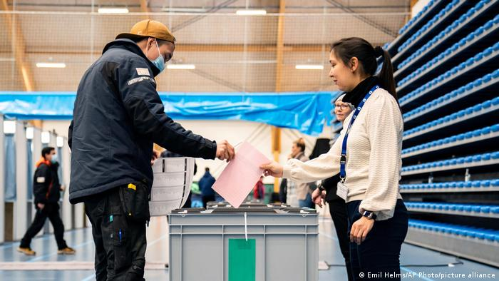man casts his ballot, for the parliamentary election, at the Inussivik arena, in Nuuk
