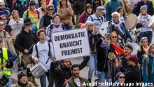 'Querdenker' demonstrators march in Stuttgart