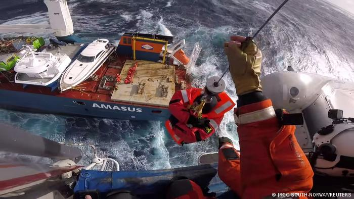 A search and rescue team hoists a crew member from Dutch cargo ship Eemslift Hendrika during an evacuation in stormy weather off the coast of Norway in the North Sea.