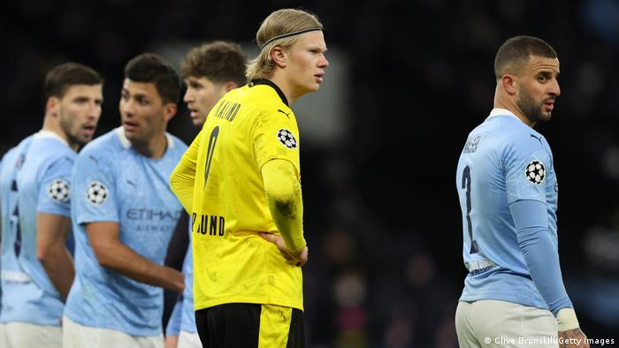 Erling Haaland stands among Manchester City defenders