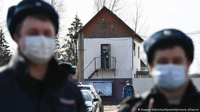 Several Russian law enforcement officers are seen at the entrance to penal colony IK-2