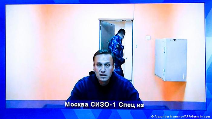 Opposition leader Alexei Navalny appears on a screen set up at a hall of the Moscow Regional Court via a video link from Moscow's penal detention center Number 1