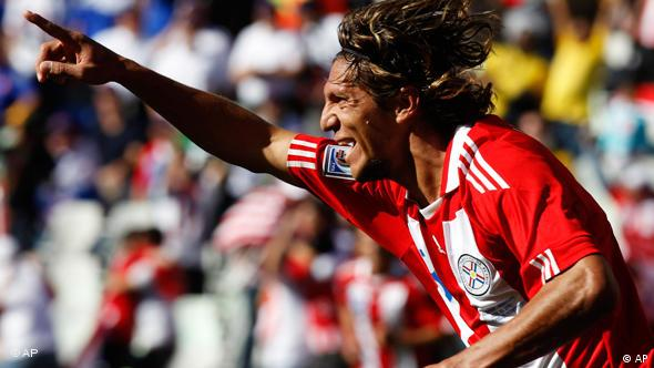 Paraguay's Enrique Vera celebrates after scoring during the World Cup group F soccer match between Slovakia and Paraguay at Free State Stadium in Bloemfontein, South Africa, Sunday, June 20, 2010.