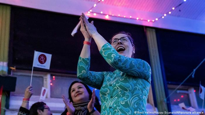 Members of Inuit Ataqatigiit celebrate the exit polls following Tuesday's parliamentary election