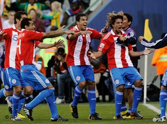 Paraguay's Enrique Vera, fourth from left, celebrates with fellow team members after scoring a goal during the World Cup group F soccer match between Slovakia and Paraguay at Free State Stadium in Bloemfontein, South Africa, Sunday, June 20, 2010.