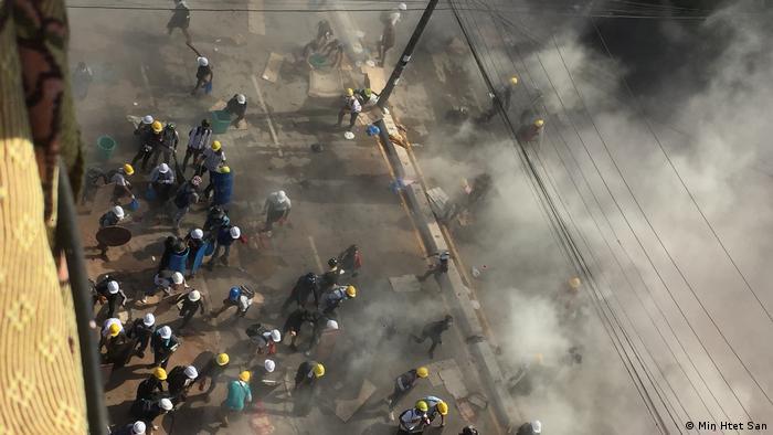 Myanmar protesters tear gas