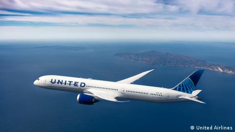 A United Airlines plane flying through the sky