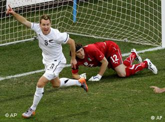 New Zealand's Shane Smeltz, left, celebrates after scoring as Italy goalkeeper Federico Marchetti looks on during the World Cup group F soccer match between Italy and New Zealand at Mbombela Stadium in Nelspruit, South Africa, Sunday, June 20, 2010. (AP Photo/Michael Sohn)