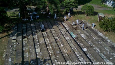 Workers in Sao Paulo, Brazil, exhuming bodies from tombs to make space for people who recently died