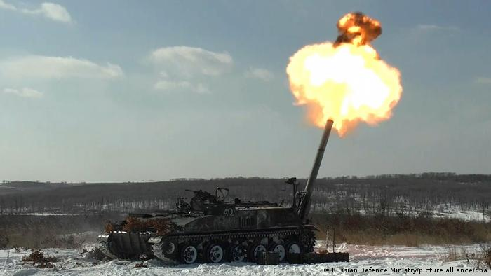 A Russian tank fires a round towards the sky