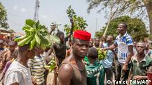 """*** Dieses Bild ist fertig zugeschnitten als Social Media Snack (für Facebook, Twitter, Instagram) im Tableau zu finden: Fach """"Images"""" —> Weltspiegel/Bilder des Tages *** A man looks on as protesters erect makeshift barricades with tires and branches during a demonstration against Benin President Patrice Talon in Toui, an opposition stronghold, on April 7, 2021. - President Talon is running for re-election in a vote on April 11, 2021, which he is favoured to win after critics say he cracked down on opponents. (Photo by Yanick Folly / AFP)"""