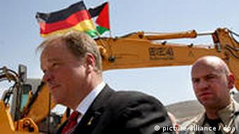 Development Minister Dirk Niebel inspecting a German-funded West Bank sewage treatment plant