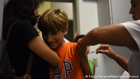 A boy is being vaccinated against yellow fever in Rio de Janeiro