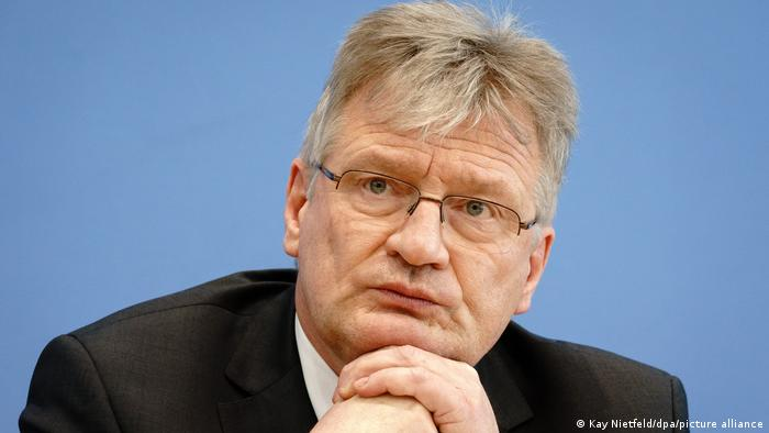 Jörg Meuthen rests his chin on his hands during a press conference
