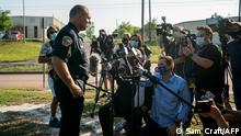 Bryan's Police Chief Eric Buske, talks to the media during a press conference outside the scene of a mass shooting in Bryan, Texas on on on April 8, 2021. - One person was dead and several in critical condition following a shooting at a business in Texas Thursday, just hours after US President Joe Biden called gun violence an epidemic and unveiled plans to tackle the crisis. The suspect was in custody, according to the police department in the east Texas town of Bryan where the attack took place. Officials said the individual shot and wounded one officer following the incident and was an employee of the cabinetry manufacturer where he carried out the shooting. (Photo by Sam Craft / AFP)