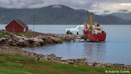 A fishing trawler in a fjord