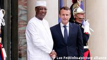 29.05.2018 (180529) -- PARIS, May 29, 2018 (Xinhua) -- French President Emmanuel Macron (R, Front) shakes hands with Chadian President Idriss Deby Itno at the Elysee Palace in Paris, France, on May 29, 2018. Rival Libyan factions on Tuesday agreed to hold credible presidential and parliamentary elections on Dec. 10 after they met here, according to a communique issued after the one-day conference on the Libya crisis. (Xinhua/Luo Fei)