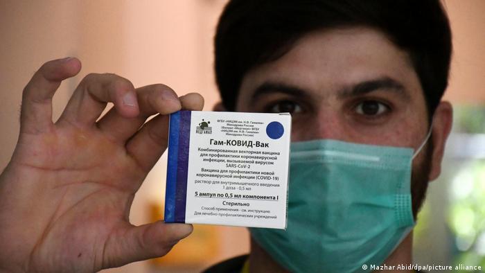 Man holding Sputnik V coronavirus vaccine