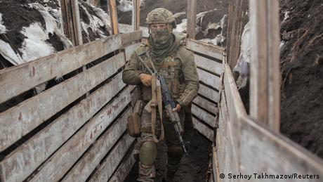 A soldier of the Ukrainian armed forces in a trench on the line of separation near Donetsk