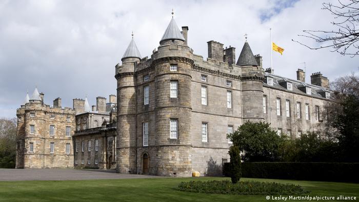 Holyrood Palace with Royal Standard flag at half-mast