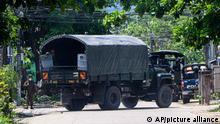 Polive vehicle blocking road in Myanmar