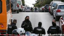 A hearse is seen on the road where Greek journalist George Karaivaz was fatally shot in the Alimos suburb of Athens