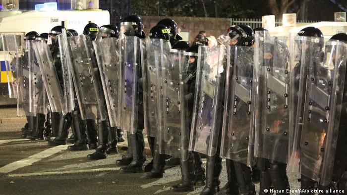 Police detain riot shields in Belfast
