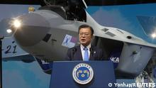 South Korean President Moon Jae-in delivers his speech in front of a prototype of the country's first homegrown fighter jet called KF-21 during its rollout ceremony in Sacheon, South Korea, April 9, 2021. Yonhap via REUTERS ATTENTION EDITORS - THIS IMAGE HAS BEEN SUPPLIED BY A THIRD PARTY. SOUTH KOREA OUT. NO RESALES. NO ARCHIVE.