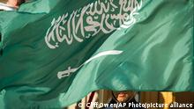 Saudi Arabia flag flies over a US soldier's face during a diplomatic visit to the Pentagon