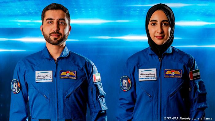 Newly named Emirati astronauts Mohammed Al-Mulla (L) and Noura Al-Matroushi (R).