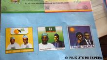 A ballot paper shows photographs of the three Benin presidential candidates and their running mates, at a polling station in Cotonou on April 11, 2021. - Benin President Patrice Talon is seeking re-election on April 11, 2021 in a tense ballot, with critics accusing him of rigging the race in his favour by sidelining opposition leaders. (Photo by PIUS UTOMI EKPEI / AFP)
