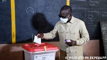 Incumbent Benin President Patrice Talon casts his ballot at the Zongo Ehuzu polling station to vote during the Benin Presidential election in Cotonou on April 11, 2021. - Benin President Patrice Talon is seeking re-election on April 11, 2021 in a tense ballot, with critics accusing him of rigging the race in his favour by sidelining opposition leaders. (Photo by PIUS UTOMI EKPEI / AFP)