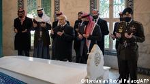 A handout picture released by the Jordanian Royal Palace on April 11, 2021 shows Jordanian King Abdullah II (C), Crown Prince Hussein (R) and Prince Hamzah (3rd-L, back) reading the Fatiha, the opening Surat of the Koran, over the tomb of late King Abdullah I at the Raghadan Palace in the capital Jordan. - Jordan's King Abdullah appeared in public alongside his half-brother Prince Hamzah, state TV showed, their first joint appearance since a palace crisis involving the prince rocked the kingdom. (Photo by - / various sources / AFP) / RESTRICTED TO EDITORIAL USE - MANDATORY CREDIT AFP PHOTO / JORDANIAN ROYAL PALACE - NO MARKETING NO ADVERTISING CAMPAIGNS - DISTRIBUTED AS A SERVICE TO CLIENTS