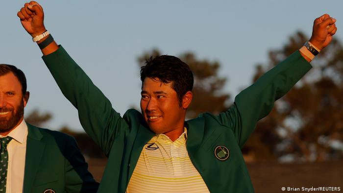 Golf champion Hideki Matsuyama raised his firsts in the air to celebrates winning The Masters