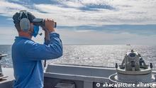 Hand out file photo dated August 18, 2020 of seaman Zachery Douglas, from Dansville, N.Y., looks through binoculars on the bridge as the Arleigh Burke-class guided-missile destroyer USS Mustin (DDG 89) conducts routine operations. A U.S. Navy warship has transited the narrow and sensitive Taiwan Strait for the second time in two weeks. Taiwan's Defence Ministry confirmed the operation on Monday amid rising tensions between China and the United States. The ministry said a U.S. destroyer, which it did not name, had sailed in a southerly direction through the strait and was continuing to sail south. Both China and the United States have been stepping up their military activities in the region, both around Chinese-claimed Taiwan and in the disputed South China Sea. U.S. Navy photo by Mass Communication Specialist 3rd Class Cody Beam via ABACAPRESS.COM