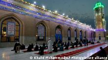 Muslims perform evening prayer at the Sunni shrine of Abdul-Qadir al-Gailani ahead of the upcoming Muslim fasting month of Ramadan in Baghdad, Iraq, Saturday, April 10, 2021. Ramadan is the ninth month of the Islamic lunar calendar and the holiest time of the year for Muslims. (AP Photo/Khalid Mohammed)