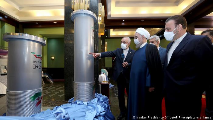 Iranian President Hassan Rouhani, second from right, listens to the head of the Atomic Energy Organization of Iran Ali Akbar Salehi while visiting an exhibition of Iran's new nuclear achievements in Tehran, Iran.