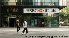 --FILE--Pedestrians walk past a branch of HSBC (the Hongkong and Shanghai Banking Corporation Limited) in Guangzhou city, south China's Guangdong province, 9 November 2018. A Chinese lawyer has urged Shanghai police to investigate the alleged illegal role of a Chinese subsidiary of UK-based banking giant HSBC in the arrest in Canada of Meng Wanzhou, chief financial officer of China's Huawei. Lawyer Li Mingqiang said in a public letter to the Shanghai police on Monday that HSBC Bank (China) Co Ltd, an HSBC subsidiary, had exposed Huawei trade secrets and breached a convention that a China-registered business entity should first report any suspected wrongdoings by its clients to Chinese authorities, instead of foreign ones. Li said in the letter that information revealed to public so far clearly shows that HSBC has disclosed, on its own initiative, trade secrets belonging to Huawei, the bank's client, to foreign governments. According to a story in the Wall Street Journal, a monitor appointed by the US government to oversee HSBC's anti money-laundering controls flagged illicit transactions made by Huawei at the bank and shared them with New York prosecutors. That led to the arrest of Meng.