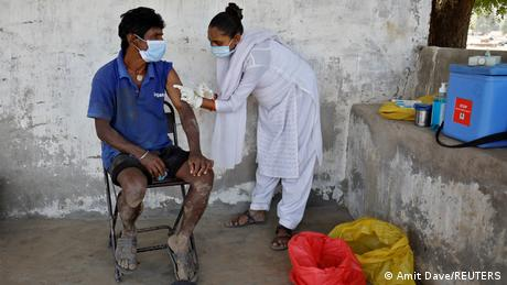 A man gets vaccinated in Kavitha village in India