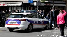 French police secure the area in front of the Henry Dunant hospital in Paris
