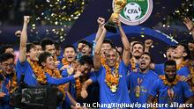 Jiangsu Suning players celebrate winning Super League