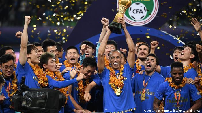 Jiangsu Suning players celebrate winning Super League