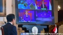 Joko Widodo and Angela Merkel Indonesian President Joko Widodo and Chancellor of Germany Angela Merkel had virtual meeting on the opening of Hannover Messe 2021, Monday (04/12). -- Rizki Akbar Putra