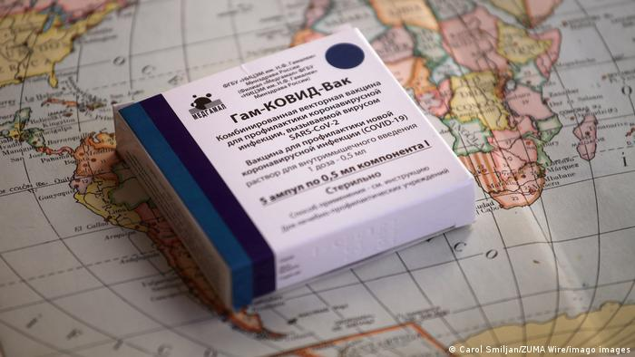 A package of Sputnik V vaccine on top of a world map.
