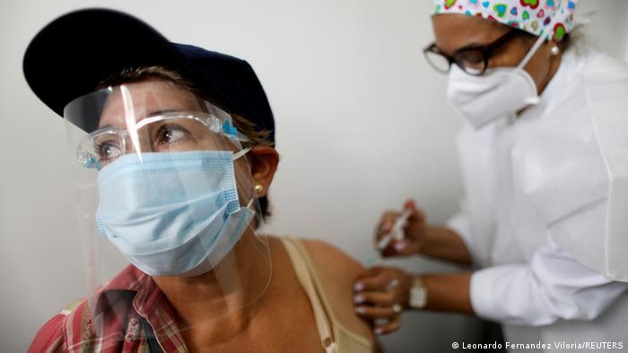 An elderly woman receives a dose of Russia's Sputnik V coronavirus disease (COVID-19) vaccine in Caracas