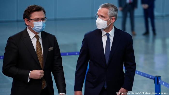 NATO Secretary General Jens Stoltenberg (R) speaks with Ukraine's Foreign Minister Dmytro Kuleba prior to a meeting at NATO headquarters in Brussels.