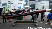 02.12.2014 Local journalists look at a model of Tienkung III (Sky Bow III) missile (front) and a Hsiungfeng III missile (back) at The Chungshan Institute of Science and Technology in Lungtan district of Taoyuan city on December 2, 2014. The most advanced home-produced surface-to-air missiles can help defend Taiwan's airspace against Chinese attacks for up to 20 years, the arms project developer said. AFP PHOTO / SAM YEH (Photo credit should read SAM YEH/AFP via Getty Images)